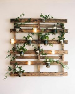 Pallet wall feature with lights (credit Pinterest)